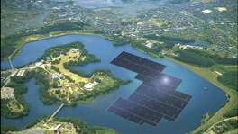 A rendering from Kyocera shows blue solar panels stretching across part of the Yamakura Dam reservoir in Japan's Chiba Prefecture. In two years, if construction goes as planned, 50,904 panels will float atop the reservoir, generating an estimated 16,170 megawatt hours annually, enough electricity to power almost 5,000 homes, according to Kyocera, the company building the solar plant.