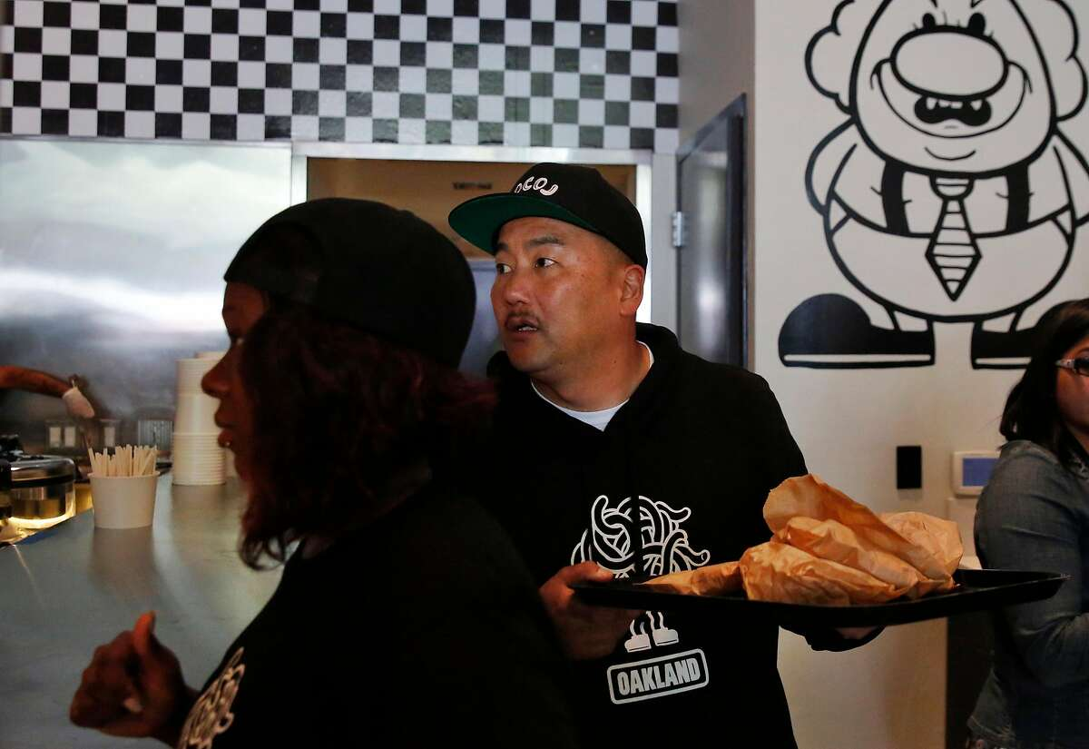 Co-founder and Chef Roy Choi takes food to his staff during the opening day of LocoL, which offers affordable and healthy fast food May 25, 2016 in Oakland, Calif. Chefs Roy Choi and Daniel Patterson are co-founders of the restaurant.