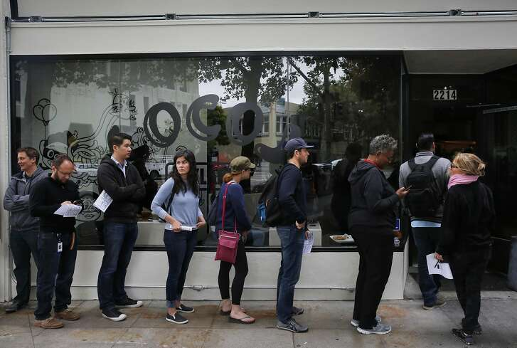 People wait in line out the door during the opening day of LocoL, which offers affordable and healthy fast food May 25, 2016 in Oakland, Calif. Chefs Roy Choi and Daniel Patterson are co-founders of the restaurant.