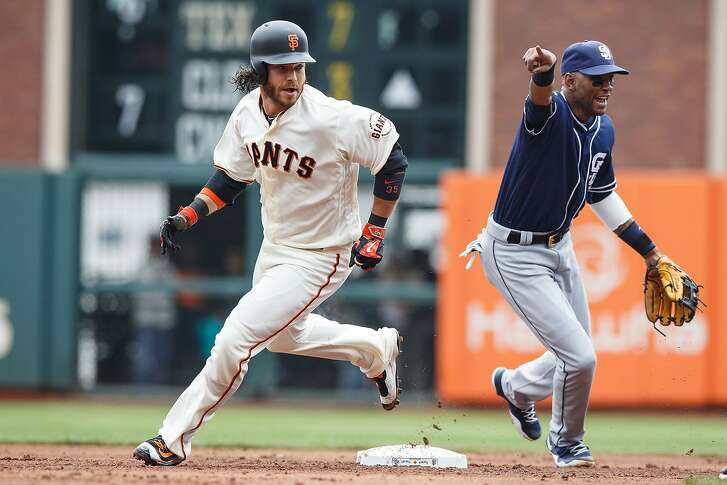 SAN FRANCISCO, CA - MAY 25: Brandon Crawford #35 of the San Francisco Giants rounds second base past Alexei Ramirez #10 of the San Diego Padres during the second inning at AT&T Park on May 25, 2016 in San Francisco, California.  (Photo by Jason O. Watson/Getty Images)