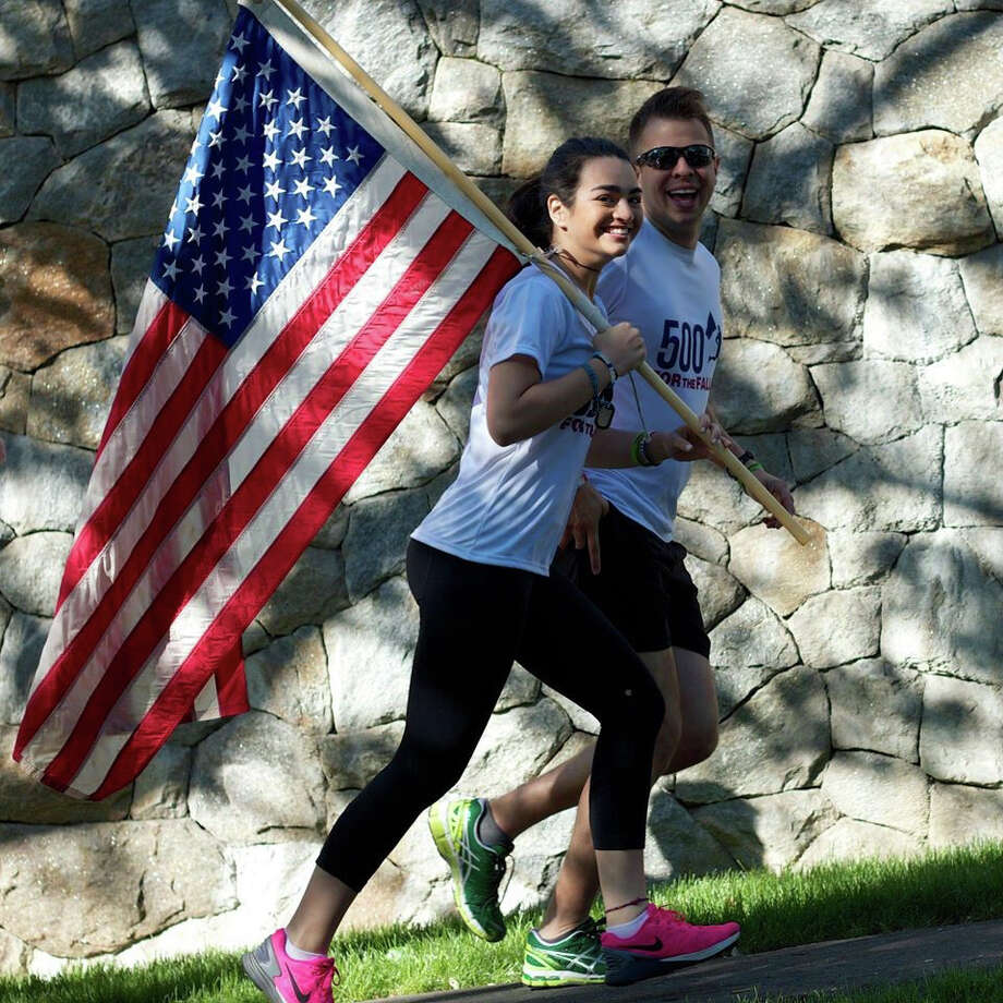 Claire Blinten and Lance Svendsen run in the Greenwich leg of the 2015 500 for the Fallen race. Both will run in the Greenwich leg of this year's race, set for Saturday, May 28, 2016. Photo: Contributed Photo