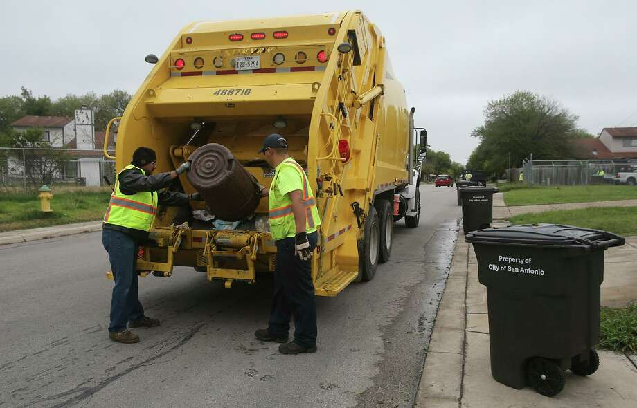 Garbage is collected in the Camelot II neighborhood. An annexation plan, in which the city of Converse will take over a swath of Camelot, will solve that area's trash collection problem. Garbage collection had been occurring as part of a pilot program with the city of San Antonio. Photo: John Davenport /San Antonio Express-News / ©San Antonio Express-News/John Davenport