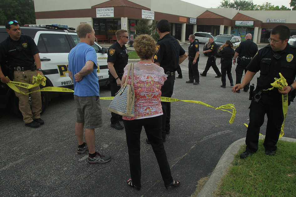 Police investigate Wednesday May 25, 2016 in a retail center parking lot where a man was grazed on the head by a bullet after another person fired a shot. According to San Antonio police sergeant Orlando Navarro the victim was transported by EMS to San Antonio Military Medical Center with non-life threatening injuries. Orlando said he did not know about a lockdown at nearby Madison High School.