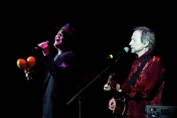 Micky Dolenz and Peter Tork of The Monkees perform last year in London. The band is releasing a 50th-anniversary album with their first new material in 20 years.