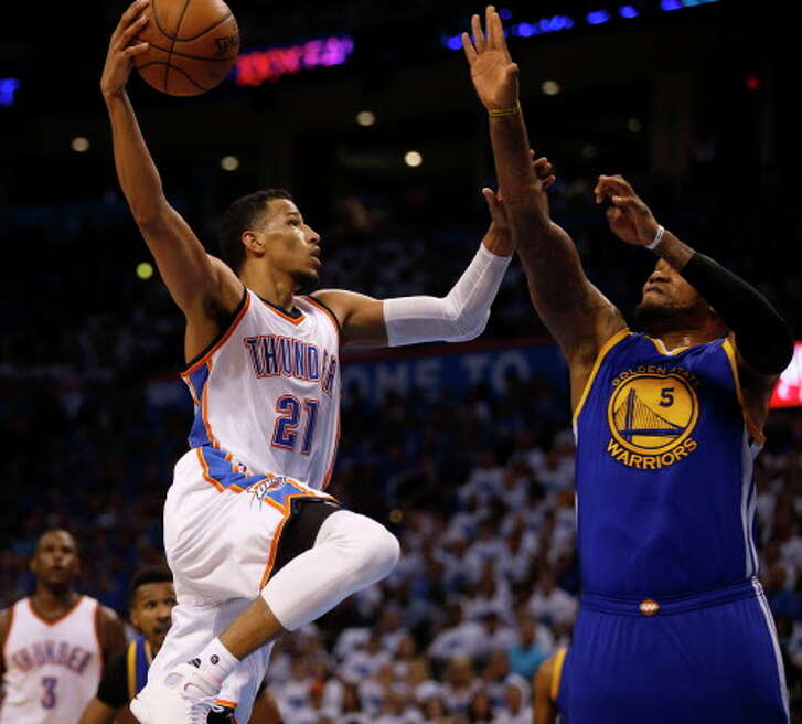 Oklahoma City Thunder's Andre Roberson (21) takes a shot against Golden State Warriors' Marreese Speights (5) during the fourth quarter on Sunday, May 22, 2016, at Chesapeake Energy Arena in Oklahoma City. (Nhat V. Meyer/Bay Area News Group/TNS)