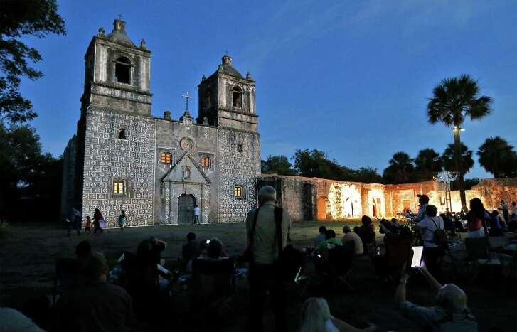 A light pattern is projected onto the front of Mission Concepcion just before sunset as guests await the actual light show as part of the World Heritage Site Celebrations on Friday, Oct. 16, 2015. The San Antonio Office of Historic Preservation hosted the event that featured a light projection on the mission of how it originally looked according to officials. Guests were also treated to tours around the mission, music and food. (Kin Man Hui/San Antonio Express-News)