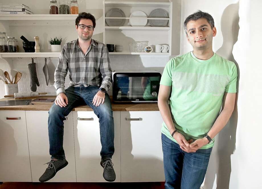 Matt Van Horn (left) and Nikhil Bhogal with their June Intelligent Oven (on counter) in San Francisco. Photo: Liz Hafalia, The Chronicle