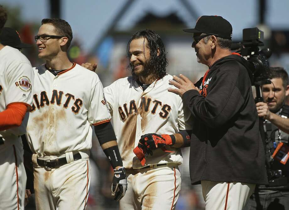 Bomb squad shortstop Kelby Tomlinson, left, and the guy he is replacing Sunday, Brandon Crawford. Photo: Eric Risberg, Associated Press