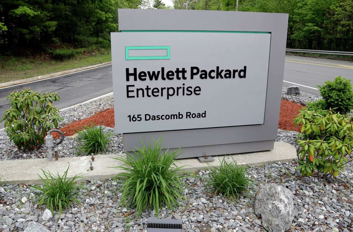A sign marks the entry way into Hewlett Packard Enterprise Tuesday, May 24, 2016, in Andover, Mass. HP Enterprise is slimming down its business further by selling off its technology-services division to competitor Computer Sciences Corp. (AP Photo/Elise Amendola) ORG XMIT: NY123
