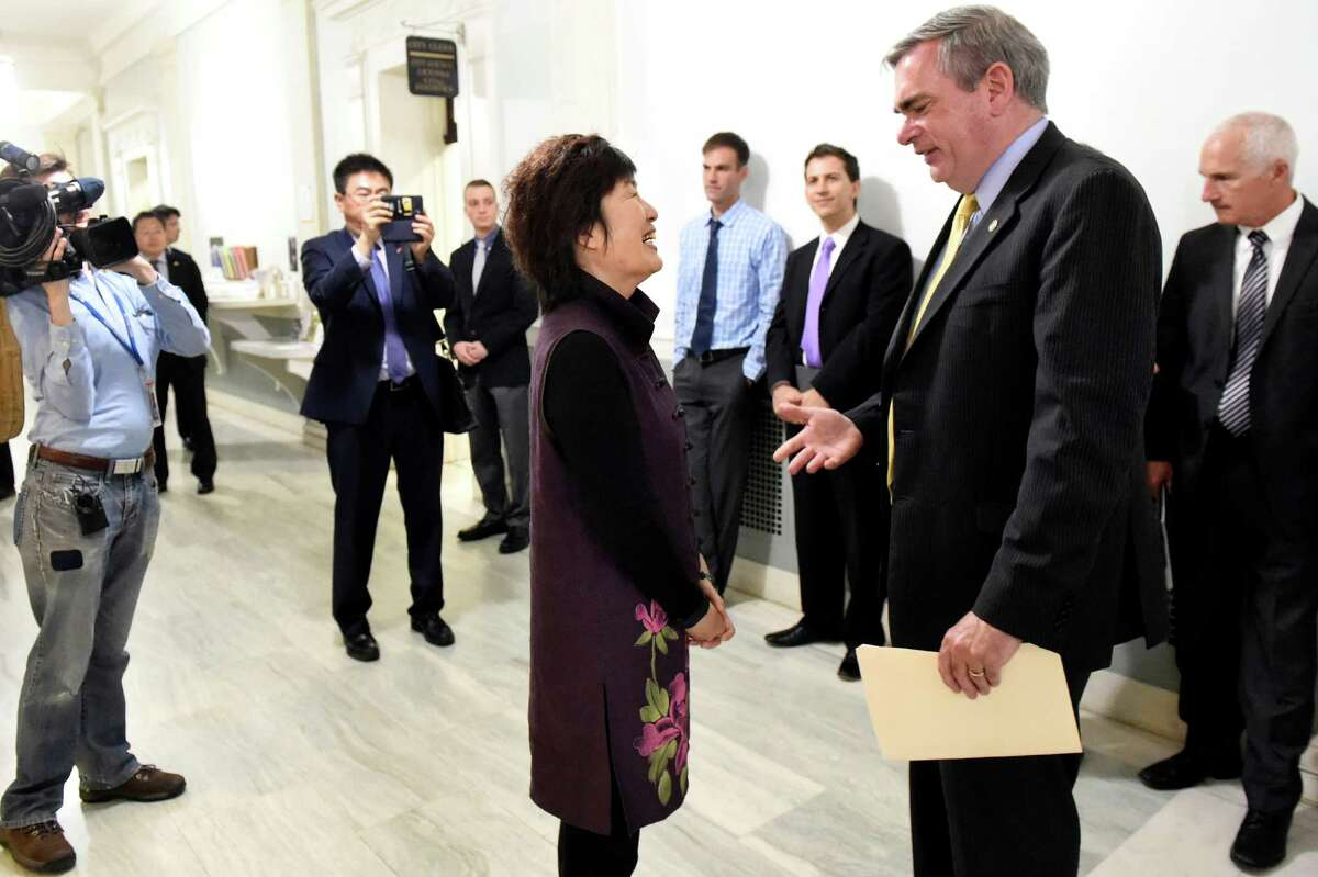 Ambassador Qiyue Zhang, center, speaks with Mayor Gary R. McCarthy, right, during a tour on Wednesday, May 25, 2016, at City Hall in Schenectady, N.Y. Representatives from the Chinese Consulate visited the city to encourage cultural and commercial ties. (Cindy Schultz / Times Union)
