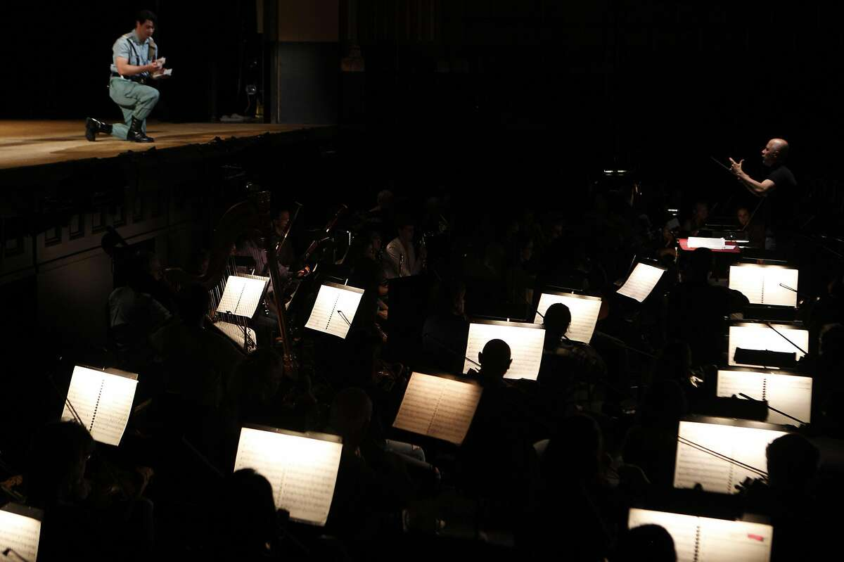 Carlos Montanaro (upper right) leads the Opera Orchestra during Wednesday's dress rehearsal of