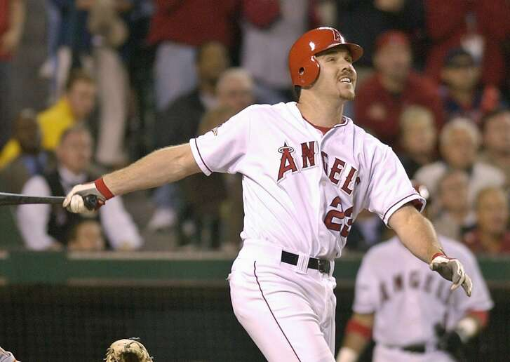 The Anaheim Angels' Scott Spiezio watches the flight of his three-run home run against the San Francisco Giants in the 7th inning of Game 6 of the World Series in Anaheim, Calif., Saturday, Oct. 26, 2002. (AP Photo/Kevork Djansezian)