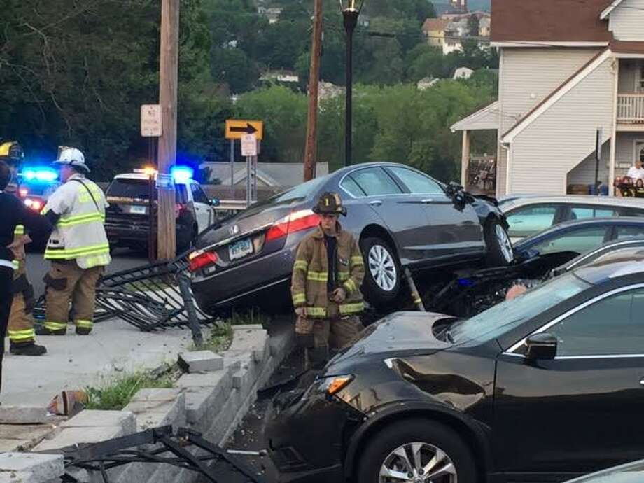 Shelton Police were investigating a Wednesday night crash involving an eastbound car that witnesses said blew through the stop sign at the corner of Coram Avenue and Wooster Street, then smashed through a wall at the Plumb Library parking lot, injuring at least one person and damaging five other vehicles. Photo: / Contributed Photo.