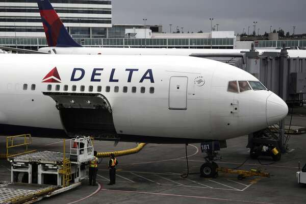 In this file photo made June 7, 2010, a Delta Airlines Inc. plane sits on the tarmac at Seattle-Tacoma International Airport in Seattle. Delta Air Lines reversed a second-quarter loss with with what it said Monday, July 19, is its largest quarterly profit in a decade thanks to strong passenger revenue.(AP Photo/Ted S. Warren, File)