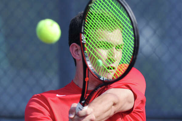 Greenwich's Will Blumberg hits during the match he won against Staples' William Andrews on Wedneday in the FCIAC tennis champinship at Wilton High School.