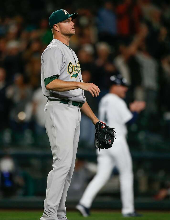 SEATTLE, WA - MAY 24:  Relief pitcher Ryan Madson #44 of the Oakland Athletics watches a walk-off, two-run homer off the bat of Leonys Martin of the Seattle Mariners at Safeco Field on May 24, 2016 in Seattle, Washington.  (Photo by Otto Greule Jr/Getty Images) Photo: Otto Greule Jr, Getty Images