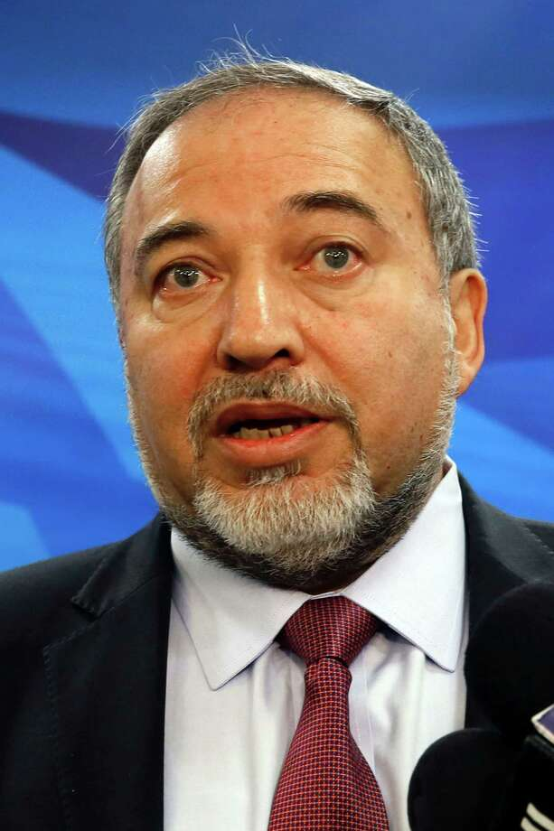 (FILES) This file photo taken on December 28, 2014 shows the then Israeli foreign minister Avigdor Lieberman speaking to the press prior to the weekly cabinet meeting in Jerusalem.  A deal has been reached to bring far-right former foreign minister Avigdor Lieberman and his Yisrael Beitenu party into Israel's governing coalition pushing it further to the right, negotiators said on May 25, 2016.   / AFP PHOTO / GALI TIBBONGALI TIBBON/AFP/Getty Images Photo: GALI TIBBON, Stringer / AFP or licensors