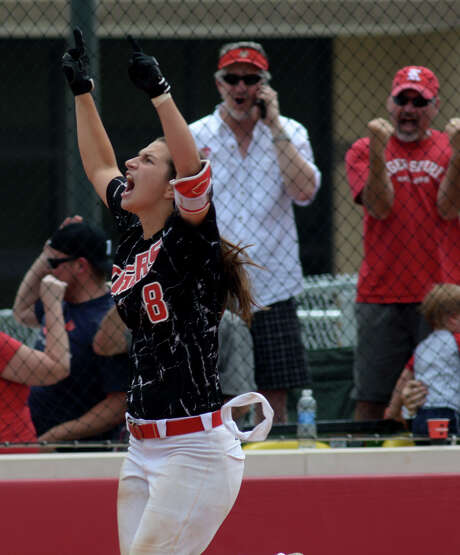 Corey Burrough helped Katy keep its hopes for a second consecutive state championship alive when she hit a walkoff home run to beat Alvin in a regional semifinal game last week. Photo: Jerry Baker, Freelance