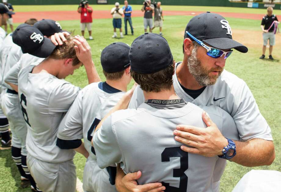 Houston Second Baptist head coach Lance Berkman embraces junior catcher Jared Prothro (3) after winning the Class 4A TAPPS state baseball championship game over Midland Christian at Baseball USA on May 25, 2016, in Houston. Second Baptist beat Midland Christian 7-2 for the title. Photo: Brett Coomer /Houston Chronicle / © 2016 Houston Chronicle