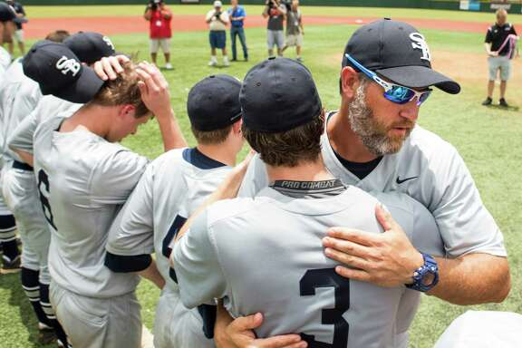 Houston Second Baptist head coach Lance Berkman embraces junior catcher Jared Prothro (3) after winning the Class 4A TAPPS state baseball championship game over Midland Christian at Baseball USA on May 25, 2016, in Houston. Second Baptist beat Midland Christian 7-2 for the title.