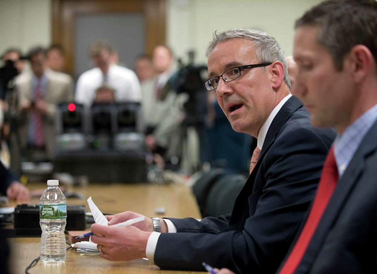 """Kevin Younis, chief operating officer for Empire State Development, speaks during a meeting of the Public Authorities Control Board at the state Capitol on Wednesday, May 25, 2016, in Albany, N.Y. The board controlled by the Legislature and Democratic Gov. Andrew Cuomo authorized spending $485 million to complete a solar panel production plant, the centerpiece of Cuomo's """"Buffalo Billion"""" economic development program. (AP Photo/Mike Groll)"""