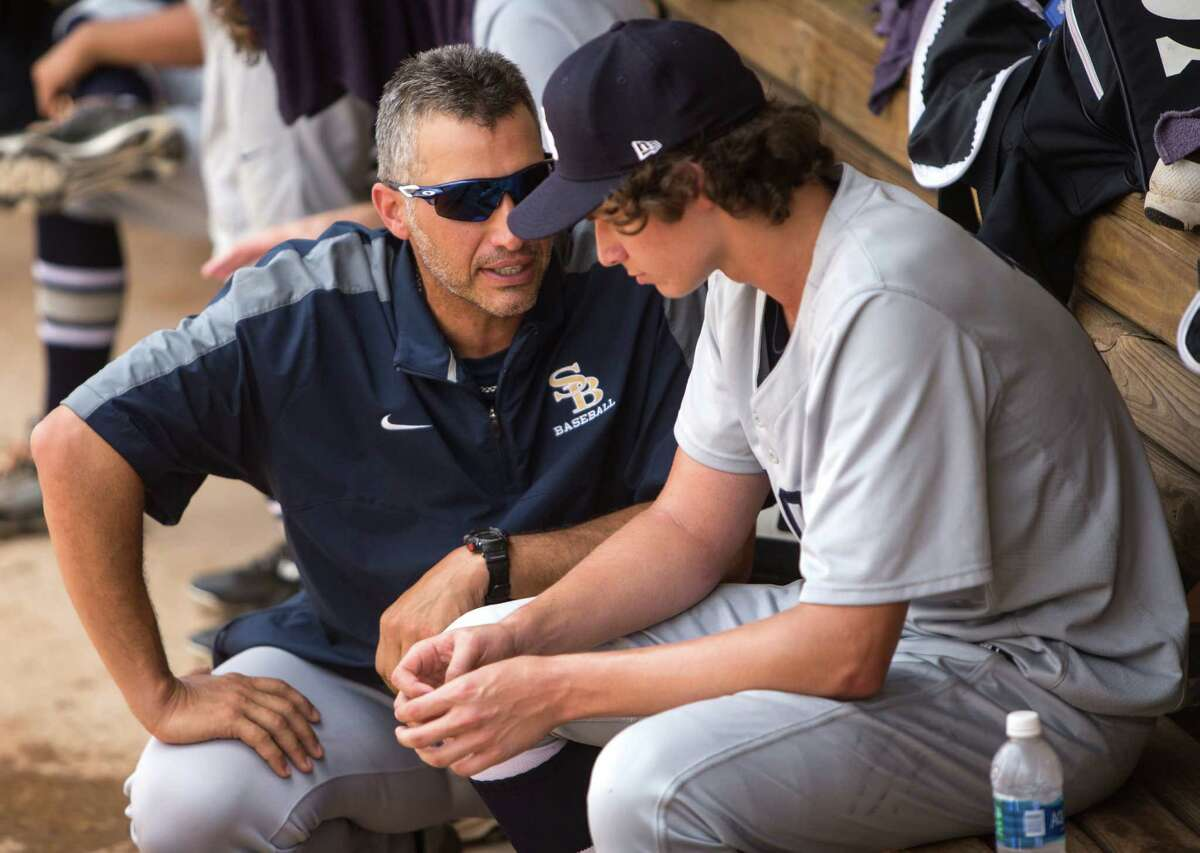 Second Baptist assistant coach Andy Pettitte offers pitcher Zachary Heaton the voice of experience.