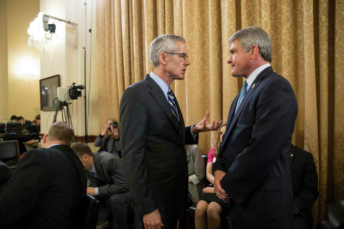 Transportation Security Administration (TSA) chief Peter Neffenger, left, confers with House Homeland Security Committee Chairman Rep. Michael McCaul, R-Texas, on Capitol Hill in Washington, Wednesday, May 25, 2016, prior to testifying before the committee's hearing on long lines at airport checkpoints. (AP Photo/J. Scott Applewhite) ORG XMIT: DCSA102