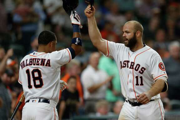 Houston Astros catcher Evan Gattis (11) celebrates his two-run home run with  Luis Valbuena (18) in the fourth inning of an MLB baseball game at Minute Maid Park,Wednesday, May 25, 2016.
