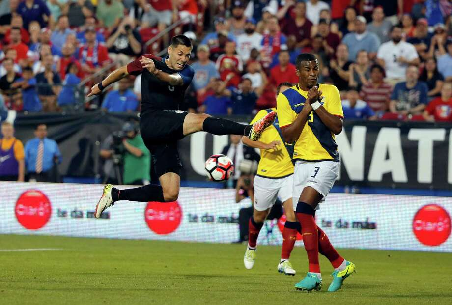 A shot by Texas native Clint Dempsey, left, is deflected by  Ecuador's Pedro Larrea. Photo: Tony Gutierrez, STF / AP