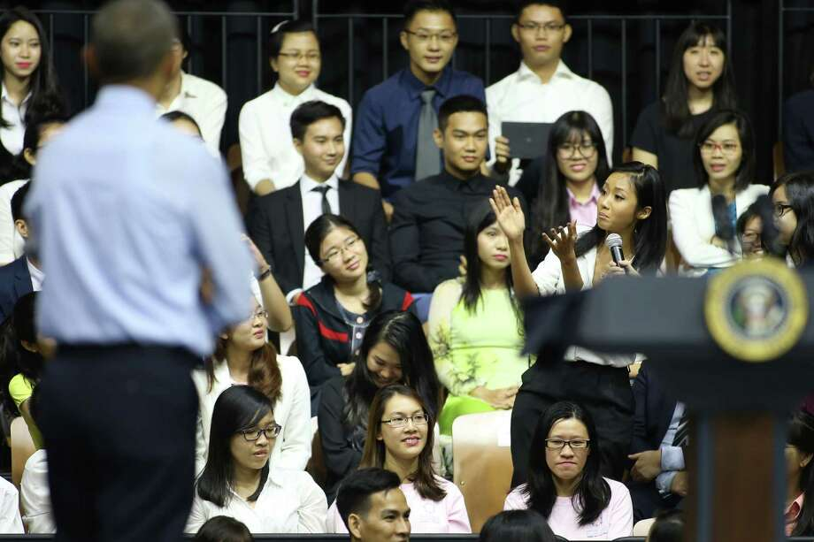 Vietnamese rapper Suboi, right, claps her hands and raps Wednesday for U.S. President Barack Obama at a town-hall style event for young leaders in Ho Chi Minh City.  Obama is wrapping up a visit to Vietnam before traveling to Japan for the G-7 summit and a visit to Hiroshima. Photo: Na Son Nguyen, STR / AP