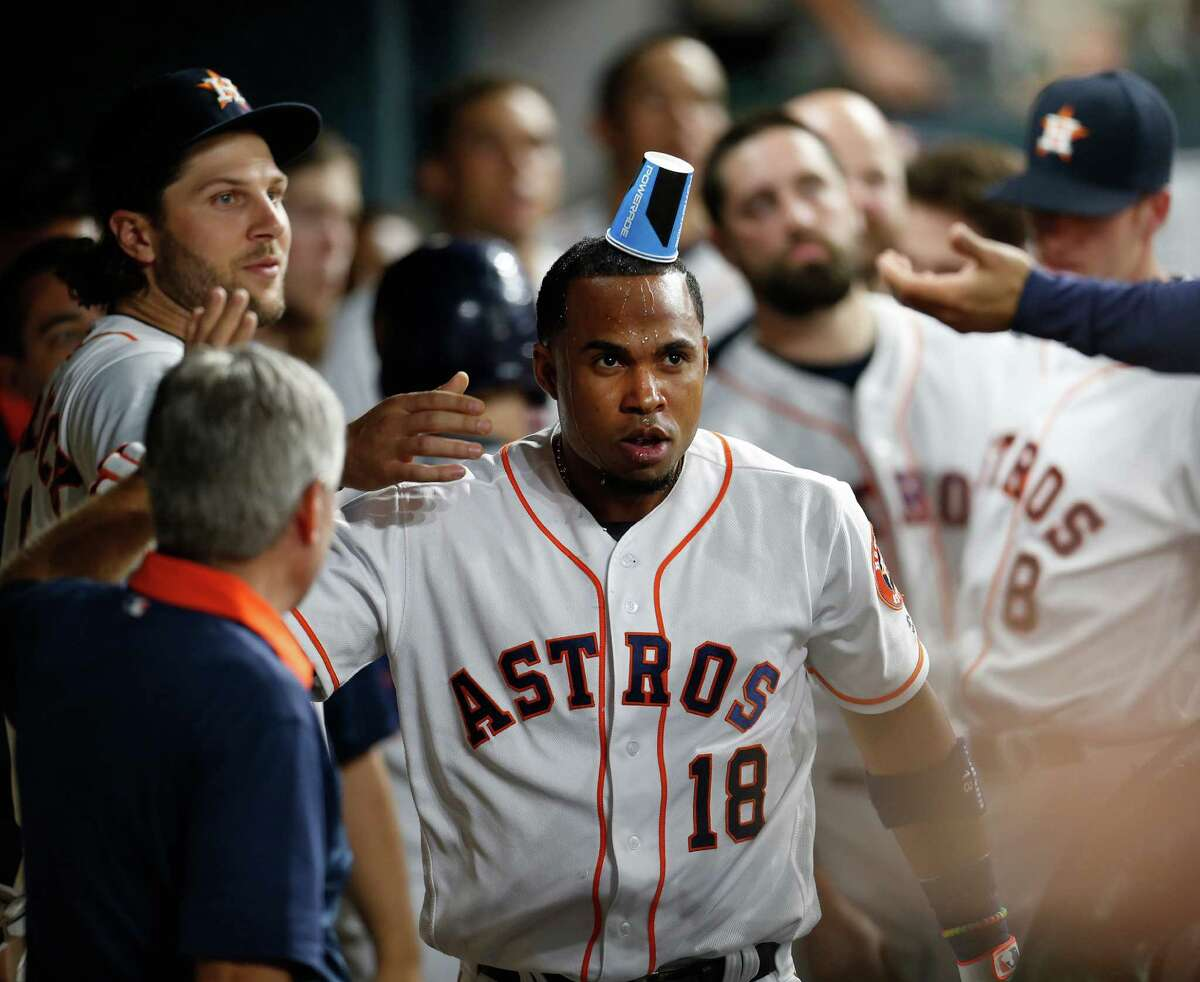 Houston Astros third baseman Luis Valbuena (18) gets doused with a cup of water by Jake Marisnick (6) in the dugout after his solo home run in the sixth inning of an MLB baseball game at Minute Maid Park,Wednesday, May 25, 2016.