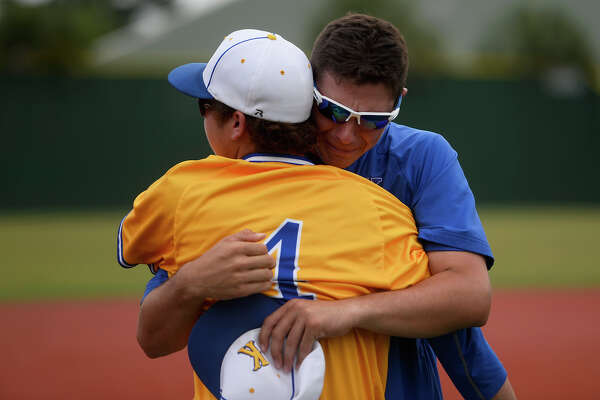 Kelly High School's Chris Messina hugs his brother, assistant coach Andrew Messina, after they lost to Prestonwood Christian Academy in the TAPPS 5A state final game in Houston on Wednesday afternoon. Kelly lost 7-1.  Photo taken Wednesday 5/25/16 Ryan Pelham/The Enterprise