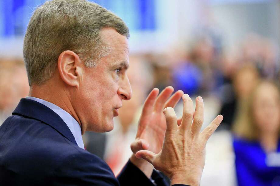 Fed banker Robert Kaplan says he is in favor of raising interest rates because the long period of near-zero rates has caused people to move money into riskier investments rather than stay in low-yielding bonds. Photo: Derick E. Hingle, Stringer / © 2016 Bloomberg Finance LP