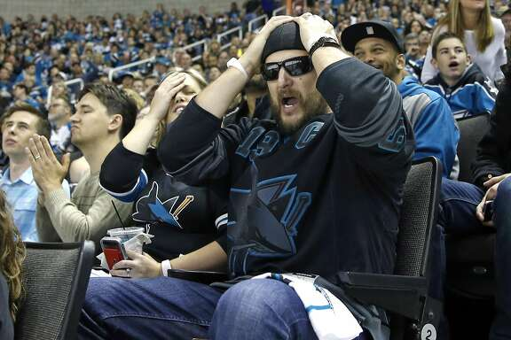San Jose Sharks' fan Robert Perez of Gilroy reacts to a missed Sharks' scoring opportunity in 1st period as Sharks play St. Louis Blues in Game 6 of NHL Playoffs' Western Conference Finals at SAP Center in San Jose, Calif., on Wednesday, May 25, 2016.