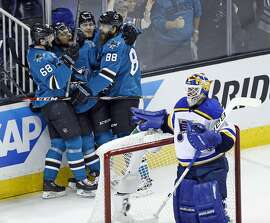 San Jose Sharks' Joel Ward (42) celebrates his 2nd period goal with Melker Karlsson (68), Chris Tierney and Brent Burns (88) against St. Louis Blues' Brian Elliott in Game 6 of NHL Playoffs' Western Conference Finals at SAP Center in San Jose, Calif., on Wednesday, May 25, 2016.
