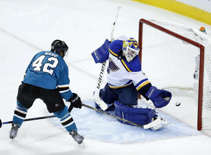 San Jose Sharks' Joel Ward scores a 3rd period goal, his second of the game, against St. Louis Blues' Brian Elliott during Sharks' 5-2 win in Game 6 of NHL Playoffs' Western Conference Finals at SAP Center in San Jose, Calif., on Wednesday, May 25, 2016.