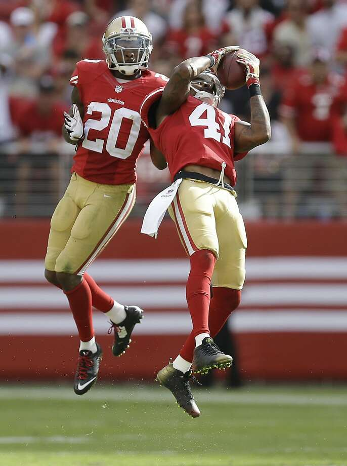 Antoine Bethea grabs an interception in the 49ers' 26-21 win over the Eagles in 2014 Photo: Ben Margot, Associated Press