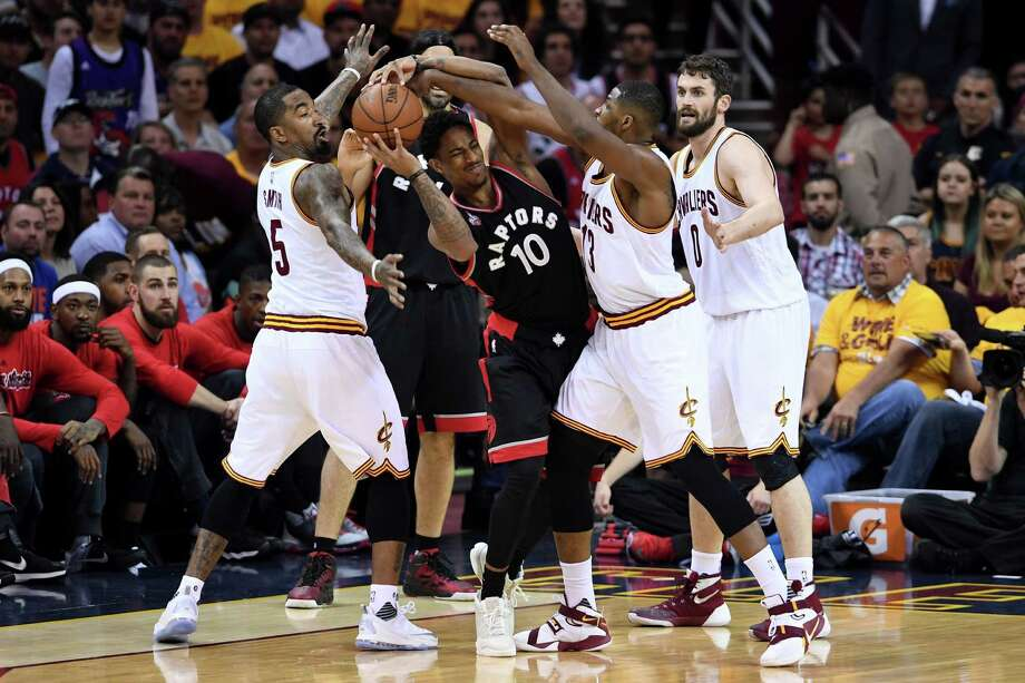 The Cavs' J.R. Smith, left, and Tristan Thompson annoy the Raptors' DeMar DeRozan with their pressure. Photo: Jason Miller, Stringer / 2016 Getty Images