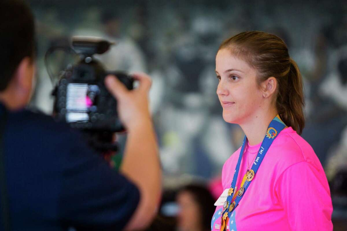Special Olympics Texas Athlete Katherine Richards, 27, is presented to the audience for the annual Flame of Hope Torch Run organized by the Houston law enforcement agencies to benefit the Special Olympics Texas Summer Games. Wednesday, May 25, 2016, in Houston.