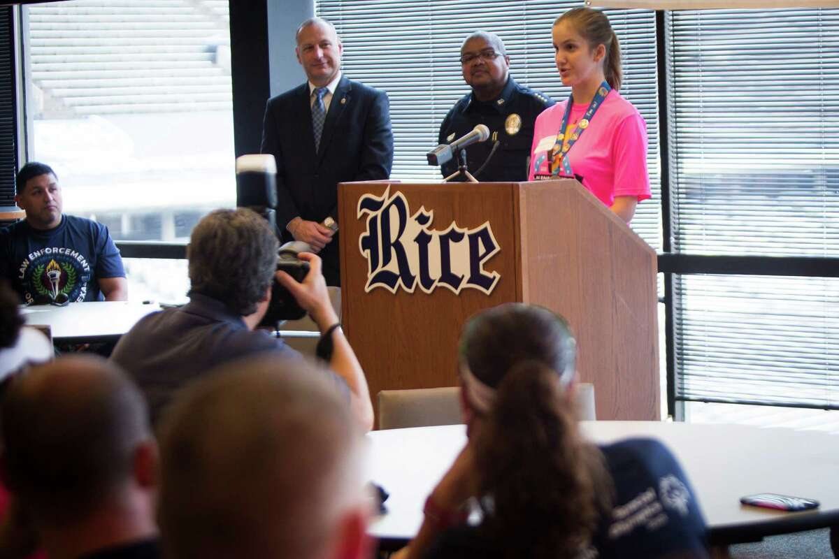 Special Olympics Texas Athlete Katherine Richards, right, 27, speaks to the law enforcement staff that is participating on the annual Flame of Hope Torch Run, Wednesday, May 25, 2016, in Houston.