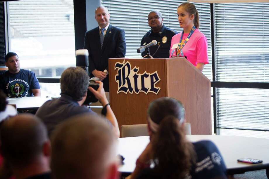 Special Olympics Texas Athlete Katherine Richards, right, 27, speaks to the law enforcement staff that is participating on the  annual Flame of Hope Torch Run, Wednesday, May 25, 2016, in Houston. Photo: Marie D. De Jesus, Houston Chronicle / © 2016 Houston Chronicle