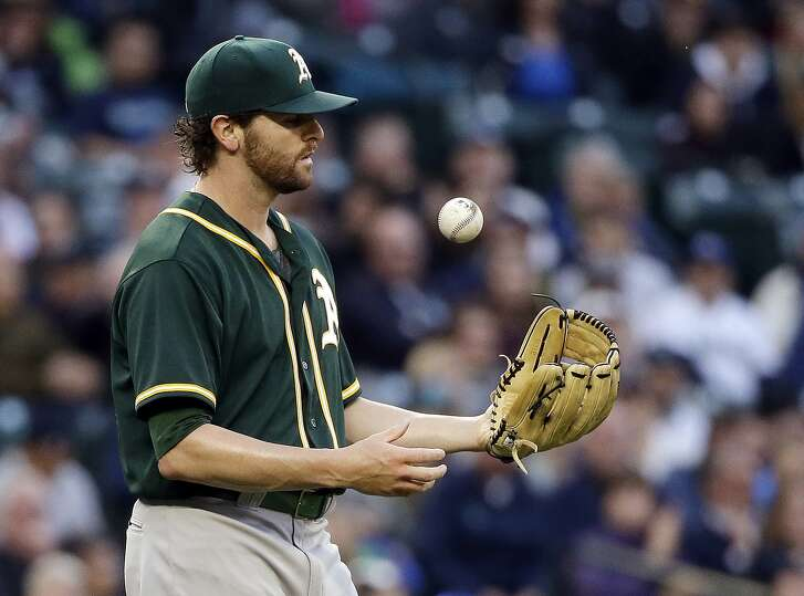 Oakland Athletics starting pitcher Zach Neal flips the ball after giving up a hit to the Seattle Mariners during the third inning of a baseball game Wednesday, May 25, 2016, in Seattle. (AP Photo/Elaine Thompson)