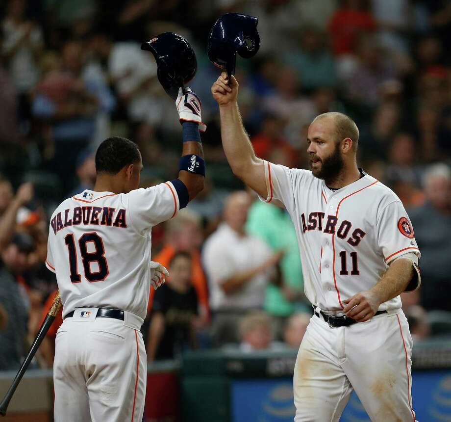 It's hats off as Evan Gattis, right, enjoys his homer with Luis Valbuena, who hit the go-ahead shot in the sixth. Photo: Karen Warren, Staff / © 2016 Houston Chronicle