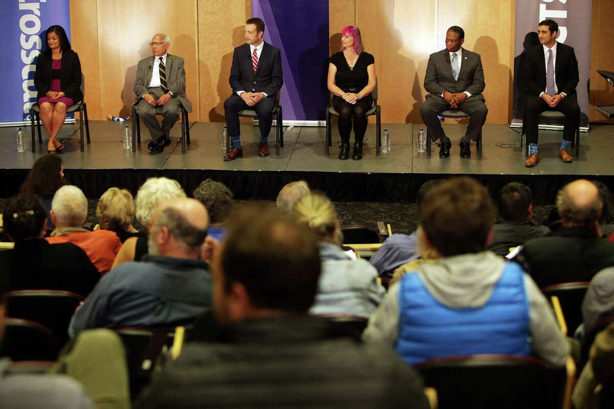 Candidates (from left) Pramila Jayapal, Arun Jhaveri, Joe McDermott, Leslie Rieger, Don Rivers and Brady Piñero Walkinshaw line the stage during the 7th Congressional District democratic primary debate, Wednesday, May 25, 2016, the University of Washington.