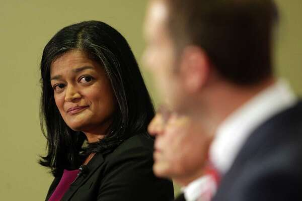 Candidate Pramila Jayapal listens as Joe McDermott answers a question during the 7th Congressional District democratic primary debate, Wednesday, May 25, 2016, the University of Washington.