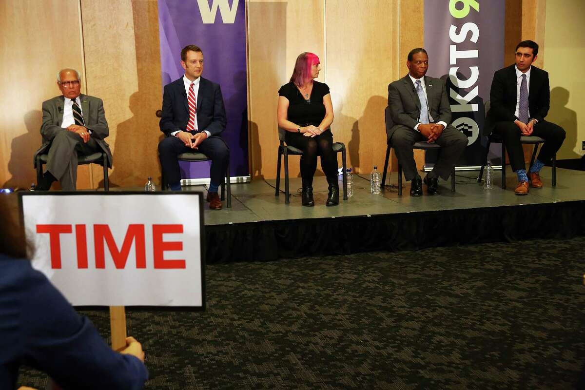 Candidate Brady Piñero Walkinshaw, right, answers a question during the 7th Congressional District democratic primary debate, Wednesday, May 25, 2016, the University of Washington.