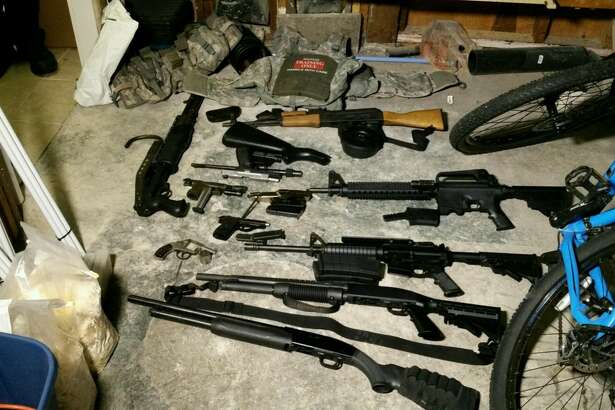 Drugs, guns and money were seized in a series of police raids on April 29. Police say the items pictured above were taken from dealers selling as part of a Seattle-area drug ring.