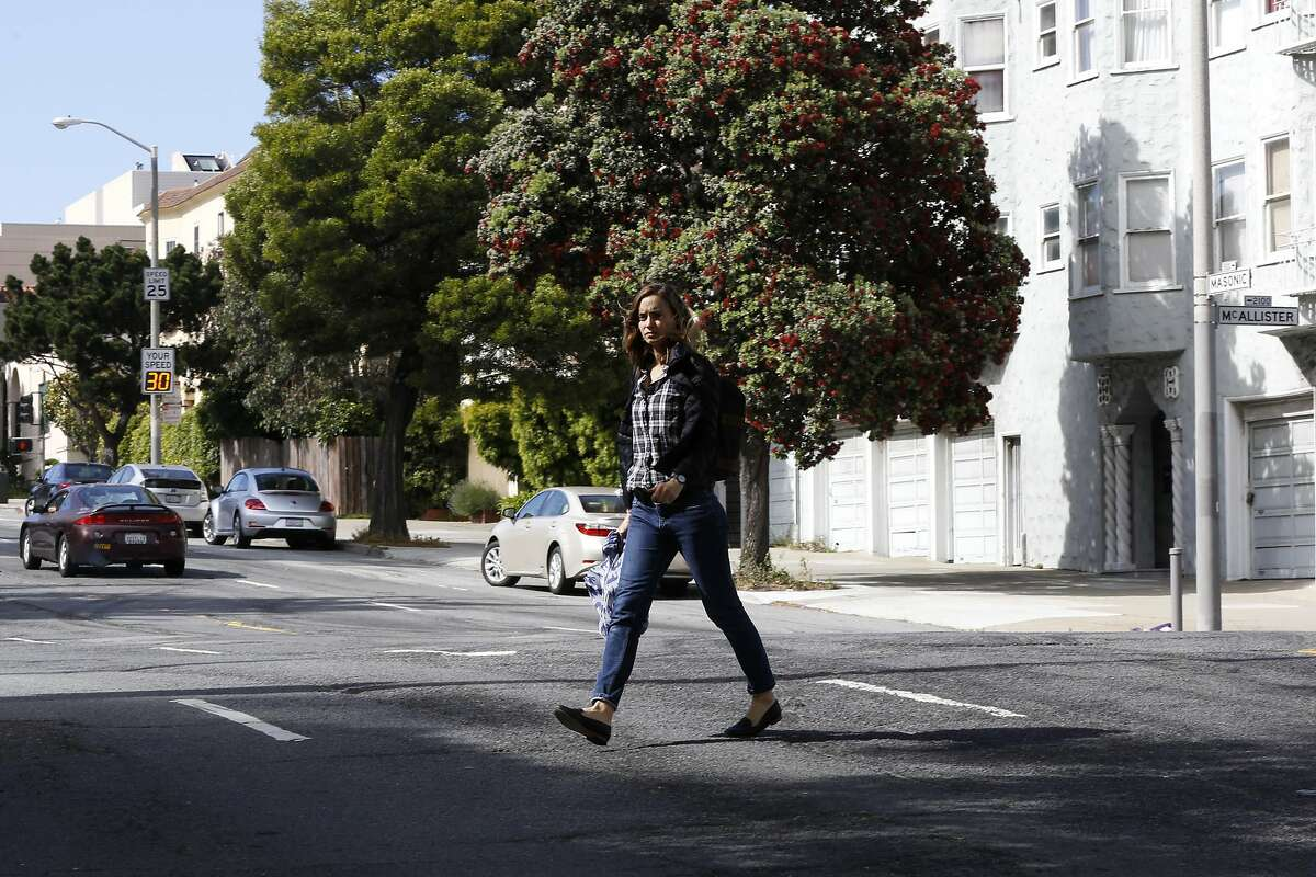 A woman crosses Masonic Avenue in San Francisco, California, on Wednesday, May 25, 2016.