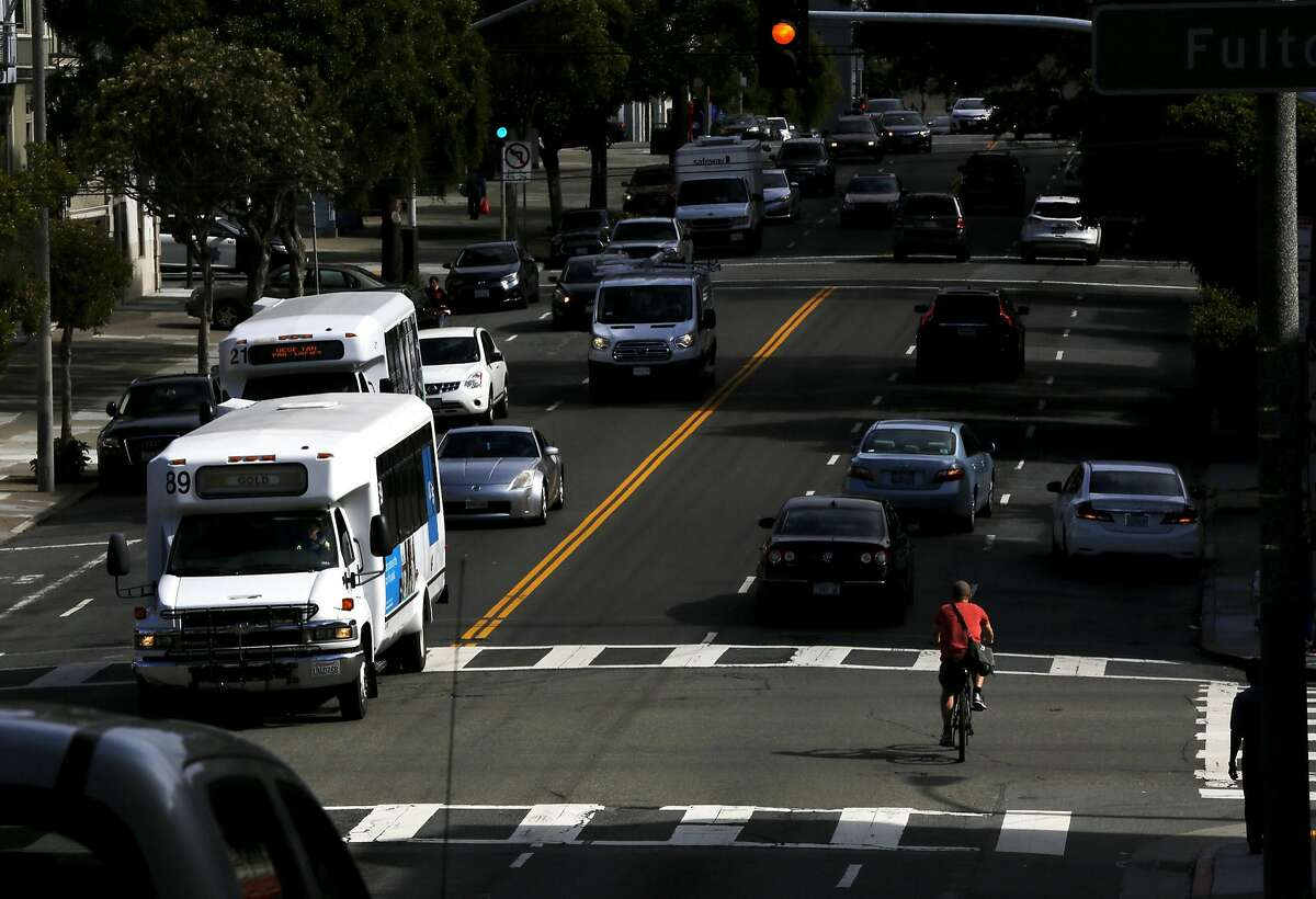 Cars and a bicyclist drive on Masonic Avenue at Fulton Street in San Francisco, California, on Wednesday, May 25, 2016.
