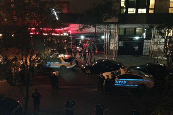Authorities stand outside Irving Plaza, near Manhattan's Union Square in New York after a shooting Wednesday, May 25, 2016. Police say several were injured in a deadly shooting inside the concert venue, where hip-hop artist T.I. was scheduled to perform. (AP Photo/Dana Schimmel) ORG XMIT: NY108